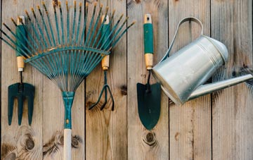 secure gardening tools in a shed or to a wall for accessibility